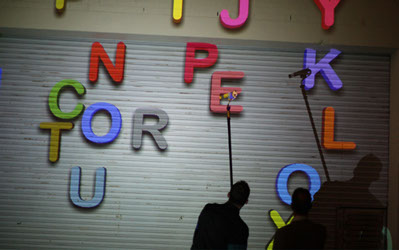 letters game, public art, magnets game, participate, leave messages on building at night, electronic art